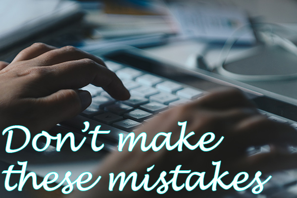 """Website designer in Ocean County image of hands on keyboard with text reading """"Don't make these mistakes"""" in script at bottom"""
